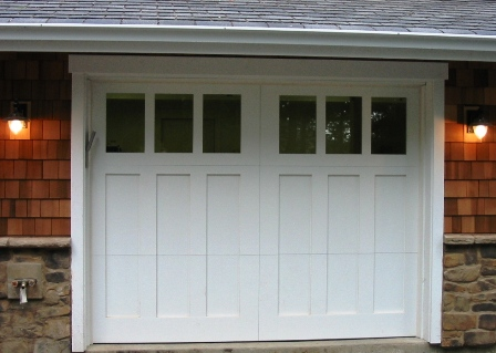 Custom Craftsman Garage Doors.   Choose the opening style that  meets your garage door  requirements:  Roll-up in  sections, Swing-out, Swing-in,  Slide, or Fold for your carriage  house garage door