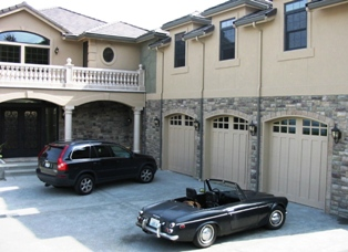 An Italian villa on the waterfront as part of the custom garage door porfolio of showcase clients.  This custom garage door has custom arches to match!