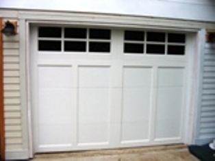 Notice how the MIDDLE RAIL and BOTTOM RAIL are BACKWARDS.  Custom Garage Doors or REAL Carriage Doors will solve this ugly situation for your carriage house garage doors.  Other opening styles for Custom Garage Doors or Carriage Doors include:  Out-Swing, In Swing, Hinged, Swinging, Slide, or Fold.  The  choice is yours for a carriage house door, custom garage doors, or real carriage doors!