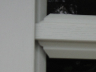 Notice how the mullions or muntins have variable spacing and leave huge GAPS or HOLES.  Custom Garage Doors or REAL Carriage Doors will solve this ugly situation for your carriage house garage doors.  Other opening styles for Custom Garage Doors or Carriage Doors include:  Out-Swing, In Swing, Hinged, Swinging, Slide, or Fold.  The  choice is yours for a carriage house door, custom garage doors, or real carriage doors!