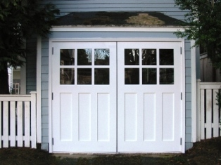 REAL hinged carriage door for your garage door built and installed to open as Swing-out Carriage Doors.  Other opening styles for these Hinged Carriage Doors include:  Swing-out, Slide, or Fold.  The choice is yours for a real carriage house door for your hinged carriage door!