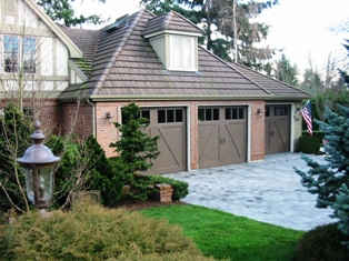 Seattle garage door in custom wood with a Z- Buck carriage house Seattle garage door design.  Located in Medina, WA as part of my Custom Seattle garage door portfolio of showcase clients.