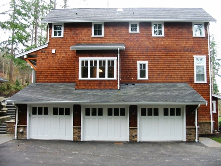 Custom Carriage Garage Doors for  your beautiful home. Built and  installed to roll up in sections  as traditional garage doors.   Other opening styles for these  Custom Carriage Style Garage Doors  include:  Swing-out, In Swing,  Slide, or Fold.  The choice is  yours for a custom carriage house  garage door!