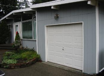 Custom Garage Doors Or REAL Carriage Doors Will Solve This Ugly Situation  For Your Carriage House