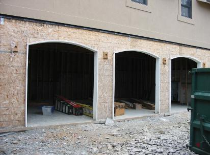 Custom Garage Doors or REAL Carriage Doors make a beautiful statement for your carriage house garage doors. Other opening styles for Custom Garage Doors or Carriage Doors include: Out-Swing, In Swing, Hinged, Swinging, Slide, or Fold. The choice is yours for a carriage house door, custom garage doors, or real carriage doors!