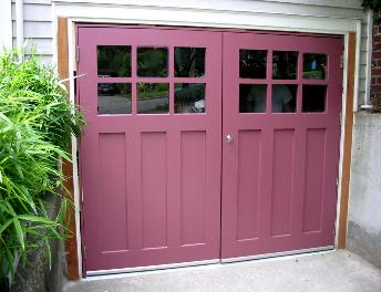 Custom Craftsman Garage Doors.  Choose the opening style that meets your garage door requirements:  Roll-up in sections, Swing-out, Swing-in, Slide, or Fold for your carriage house garage doo