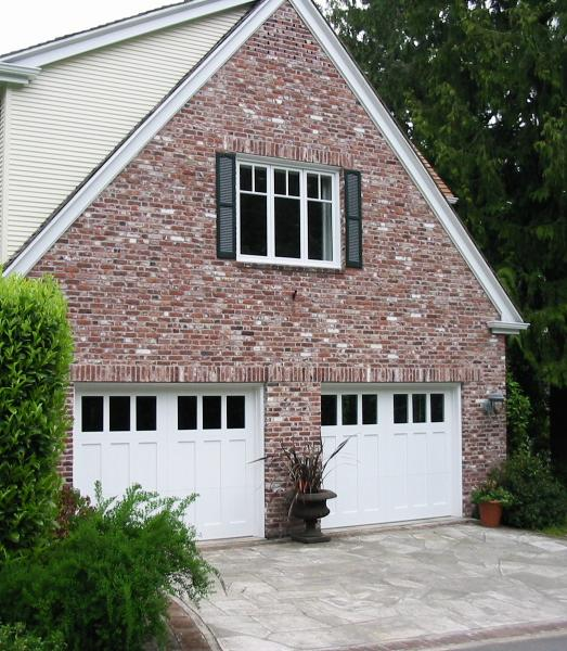 Custom Craftsman Garage Doors.  Choose the opening style that meets your garage door  requirements:  Roll up in sections, Swing-out, In Swing, Slide, or Fold for your carriage house garage doors