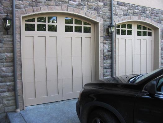 Custom Carriage Garage Doors for  your Italian Villa. Built and installed to roll up in  sections as traditional garage  doors.  Other opening styles for  these Custom Carriage Style Garage  Doors include:  Swing-out, In  Swing, Slide, or Fold.  The choice  is yours for a custom carriage  house garage door!