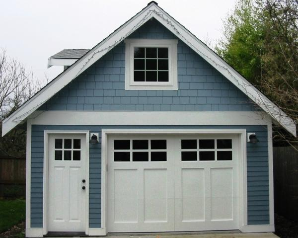 Custom Garage Doors havel transformed this beautiful carriage garage with carriage house garage doors. Other opening styles for Custom Garage Doors or Carriage Doors include: Out-Swing, In Swing, Hinged, Swinging, Slide, or Fold. The choice is yours for a carriage house door, custom garage doors, or real carriage doors!