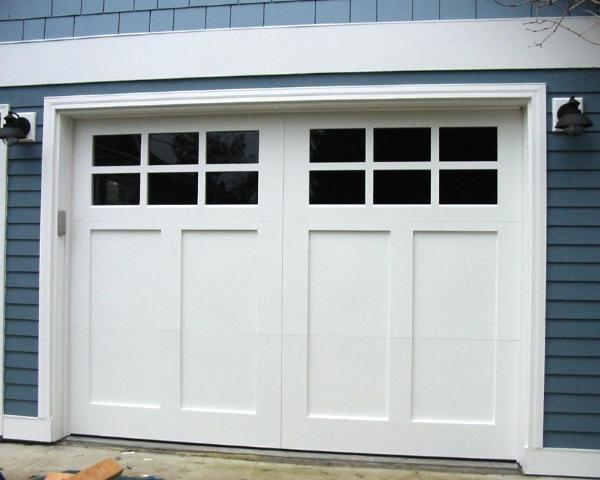 Hand made custom wood garage doors and real carriage house for Garage doors styles