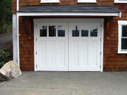Hinged carriage door installed in a carriage door garage.  Choose the opening style that meets your garage door requirements:  Roll-up in sections, Swing-out, Swing-in, Slide, or Fold for your carriage house doors.