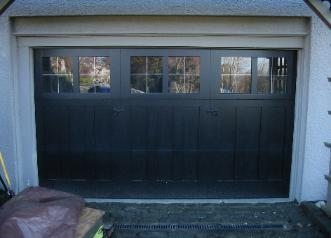 A custom eleven and one half foot wide three door custom garage door solution; Anne Wright English Tudor in Tacoma